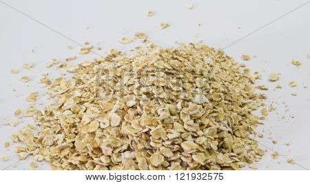 Narrow depth of field shot of rolled oats on white background