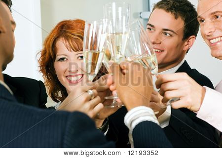People in business outfit celebrating something in the office