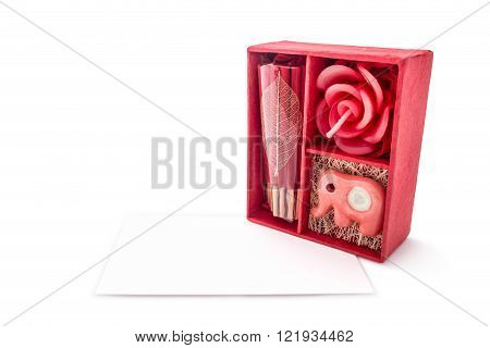 Beautiful red keepsake gift boxes and card isolated on white background.