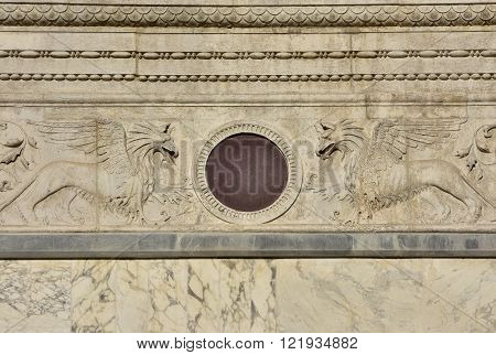 Detail of Scuola Grande di San Marco renaissance facade in Venice with two relief of griffins and decorations (now the entrance of Venice main hospital)