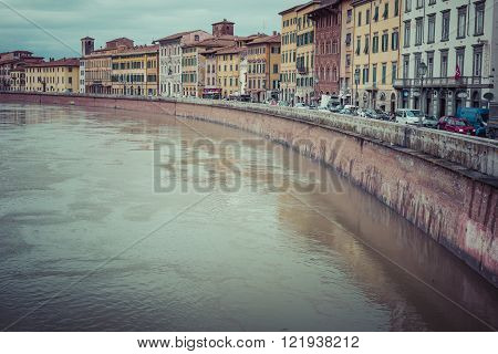 Pisa, Italy - March 10, 2016: River Arno Floating Through The Medieval City Of Pisa In Italy, On Mar