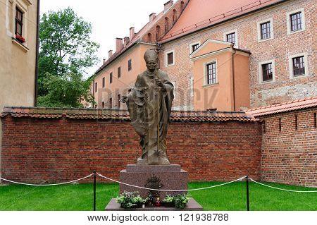 Bronze statue of Karol Wojtyla at Wawel Castle in Krakow, who was later anointed Pope John Paul II.