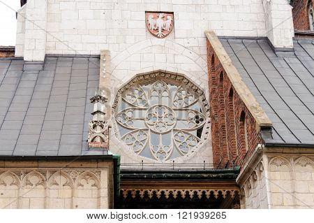 Rosette window above the west entrance to the Wawel Cathedral