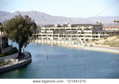 The harbor entrance to Lake Havasu City with houses and apartment buildings on Lake Havasu.