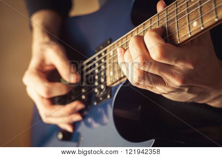 Young men playing guitar close up shot