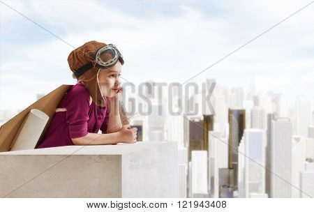 Little child girl plays astronaut. Child looking at city. Child in an astronaut costume plays and dreams of becoming a spaceman.
