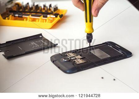 Mobile phone repairing process close up shot