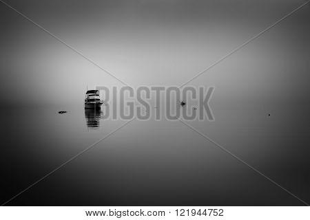 Foggy sunrise at Panorama Point in Vancouver BC featuring a calm ocean with sunrise reflections on the smooth water
