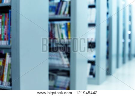 Blured books in public library. Blured effect. Background.