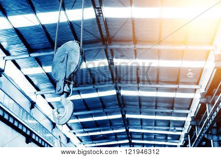 Factory floor industrial lifting hook in operation
