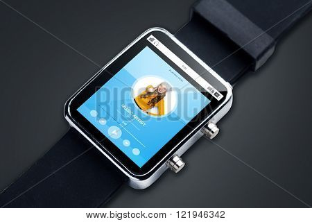 modern technology, object and media concept - close up of smart watch with media player music track on screen