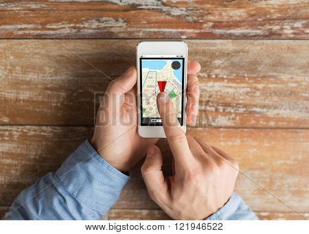 people, navigation and technology concept - close up of male hands holding smartphone with gps navigator map