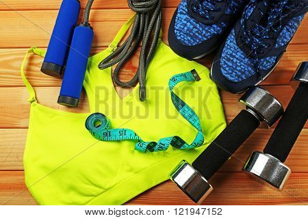 Sport clothes and equipment on wooden background