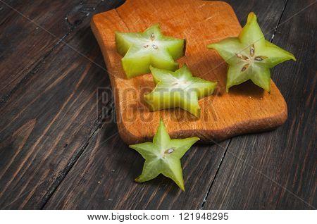 Carambola - starfruit on wooden background. exotic fruit.