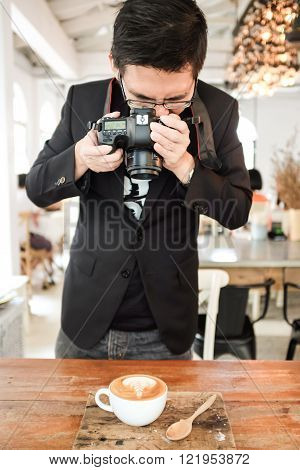 Asian hipster busines man take coffee photo