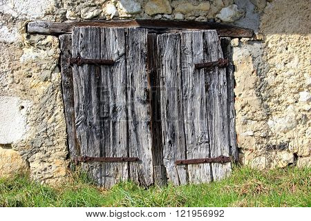 old, rustic and weathered barn door outdoors