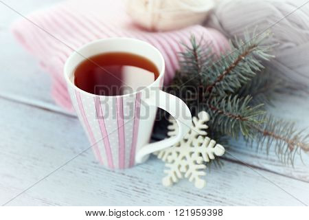 Beautiful winter composition with cup of hot drink, on wooden table