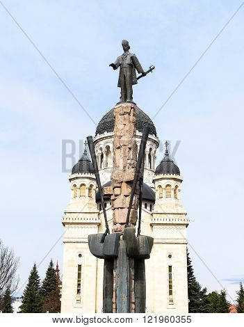 CLUJ NAPOCA, ROMANIA - MARCH 2016: Statue of Stephen Bocskay and the Dormition of the Theotokos Cathedral on 06th of March in Cluj Napoca, Romania