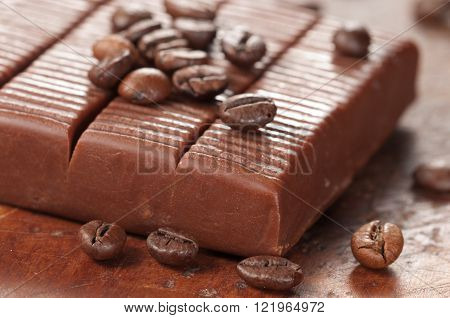 Toffee candy with coffee, close up shot, local focus