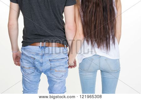 Vertical Shot Of A Seductive Couple Wearing Jeans
