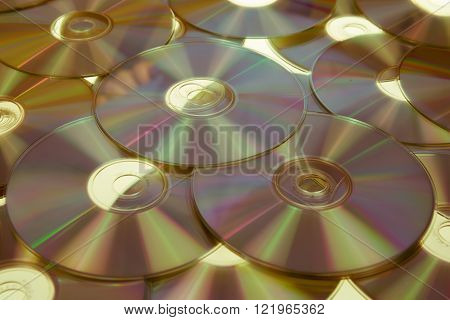 Yellow Compact Discs Background - Cd Or Dvd Blue Ray
