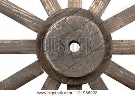 Side front closeup view of weathered hub and spokes of vintage handmade ornamental wooden wagon wheel on white
