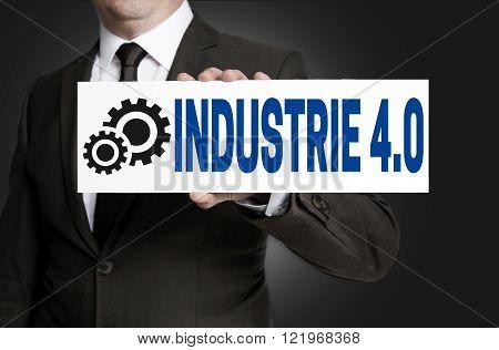 industrie 4.0 in german industry sign is held by businessman