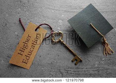 Higher Education key tag with graduation cap