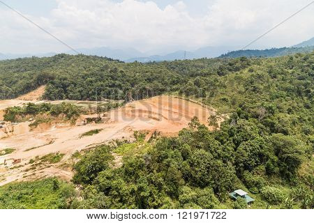 Aerial View Of Tropical Jungle Clearing For Development