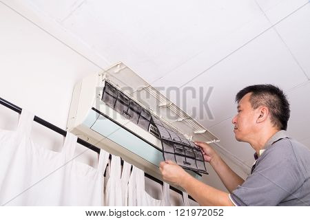 Series Of Technician Servicing The Indoor Air-conditioning Unit. Inspecting Filter.