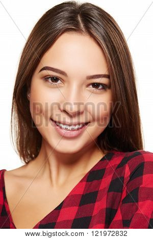 Teen female smiling with braces on her teeth