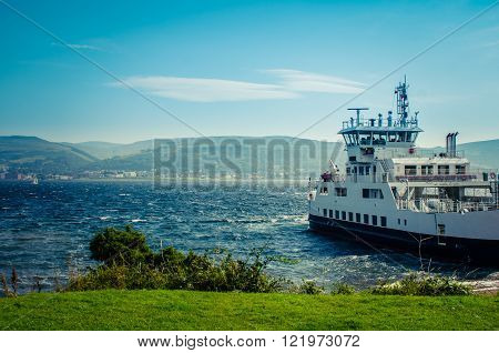 A Car Ferry Leaving Port From A The Scottish Island Of Great Cumbrae