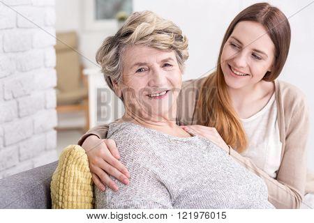 Shot of a granddaughter hugging her grandma