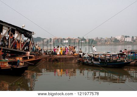 KOLKATA, INDIA - JAN 17: Passengers leave the river ferry boat at the Dakshineswar dock on January 17, 2013. Third biggest indian city Kolkata with suburbs is home to approximately 14.1 mill people