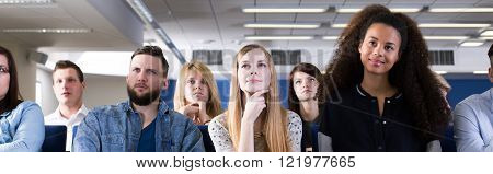Young curious students on university interested in lecture with professor listening carefully
