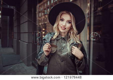 Beautiful Girl Posing Near Glass Wall Of The Shopping Center.