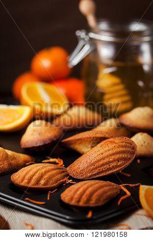 Fresh homemade orange and honey madeleines cookies