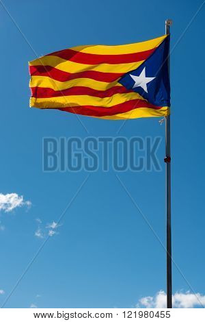 Waving flag of Catalonia (Blue estelada) over blue sky background