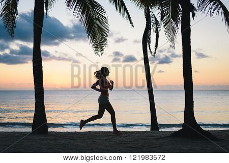 Woman Running At Dusk On Tropical Beach
