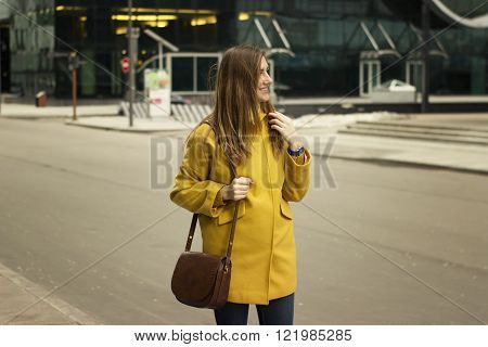 Beautiful young woman stand on the high-rise buildings backround
