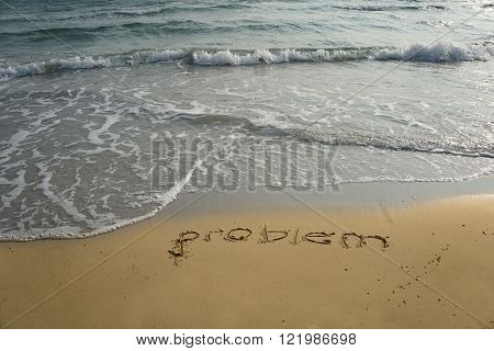 Handwriting word problem written in the sand
