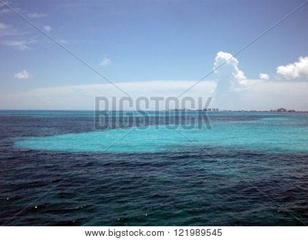 A black-to-blue colour border of the Mexican Caribbean sea near Cancun caused by the presence of a submarine coral reef.