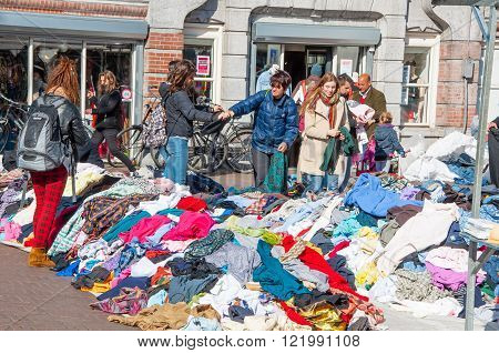 Amsterdam-April 30: Clothing in a sale on daily Flea market Waterlooplein (Waterloo Square) on April 30 2015 the Netherlands.