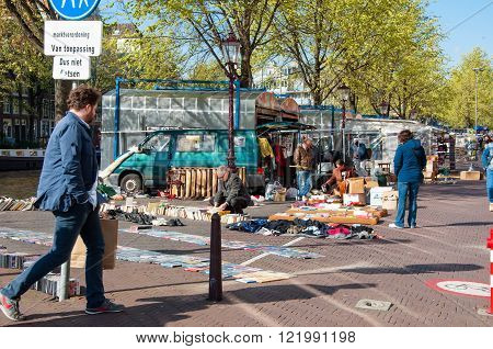 Amsterdam-April 30: Famous daily flea market on Waterlooplein merchants display their bric-a-brac and old books for sale on April 302015 the Netherlands.