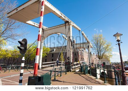 Amsterdam-April 30: Magere Brug also known as Skinny Bridge on April 30 2015 Netherlands. Bridge provides a nice spot to take in sweeping views of the Amstel river with the Carré Theatre close by.