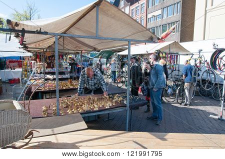Amsterdam-April 30: Flea market on Waterlooplein merchants display their bric-a-brac for sale on April 302015 the Netherlands.