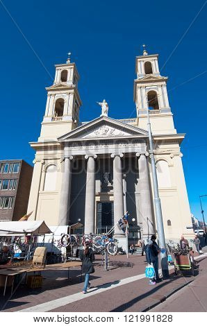 Amsterdam-April 30: Waterlooplein Amsterdam with the Mozes Aaron Church on April 30 2015 the Netherlands. The Moses and Aaron Church is officially the Roman Catholic Church of St. Anthony of Padua.