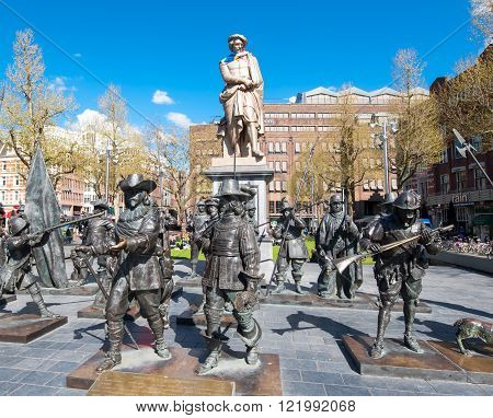 Amsterdam-April 30: Rembrandtplein with a bronze-cast representation The Night Watch by Russian artists Mikhail Dronov and Alexander Taratynov on April 30 2015 the Netherlands.