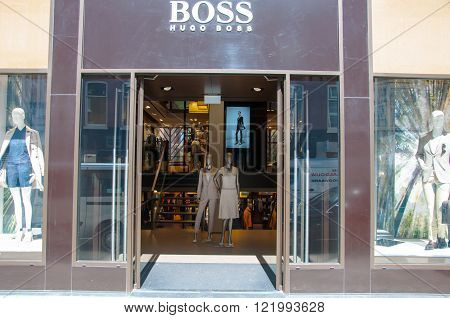 AMSTERDAM-APRIL 30: Boss store in the P.C.Hooftstraat shopping street on April 302015 in Amsterdam. The German luxury fashion and style house was founded in 1924 by Hugo Boss.