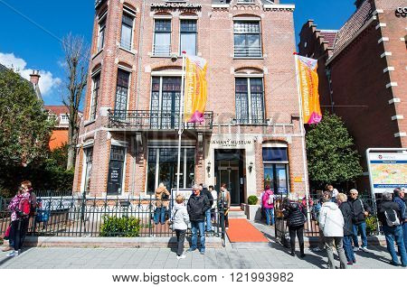 AMSTERDAM-APRIL 30: The Diamond Museum Amsterdam group of tourists on the street on April 302015 the Netherlands. The Diamant Museum is a diamond-themed museum located in the city's museum quarter.